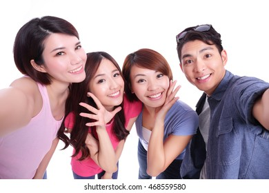 Happy teenagers taking pictures by themselves isolated on white background, asian
