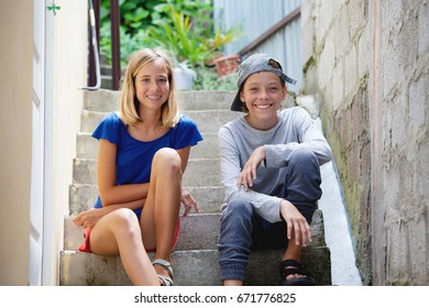 Happy teens outdoors. Smiling boy and girl. Friends