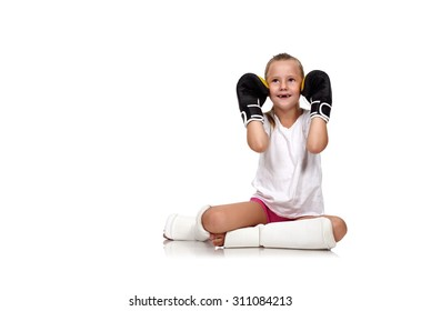 happy thai boxing girl sitting on floor