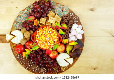 Happy Thanksgiving cheese and dessert grazing platter charcuterie board with pumpkin and apple pie, with copy space.