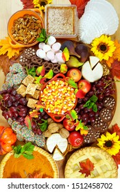 Happy Thanksgiving cheese and dessert grazing platter charcuterie board with pumpkin and apple pie.