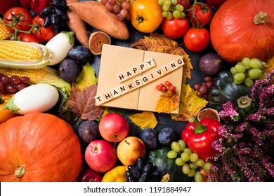 Happy thanksgiving day background. Autumn fruits vegetables and leaves. Thanksgiving concept. Top view with copy space