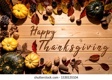 Happy Thanksgiving Day with pumpkin and nut on wooden background