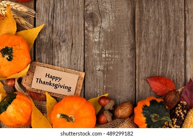 Happy Thanksgiving Gift Tag With Bottom Corner Border Of Colorful Leaves And Pumpkins Over A Rustic