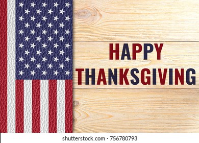 happy thanksgiving, greeting card with us flag on wooden table
