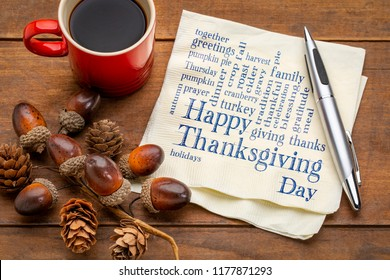 Happy Thanksgiving word cloud - handwriting on a napkin with a cup of coffee and fall decoration