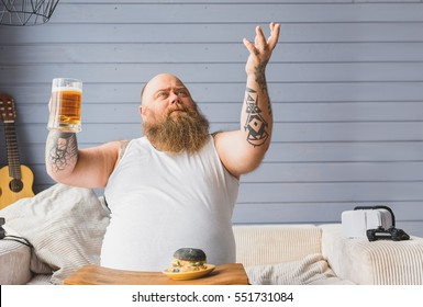 Happy thick guy is grateful for beer