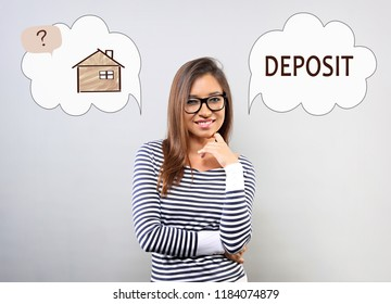 Happy thinking latina woman in eyeglasses looking and thinking deposit or buying to house. Concept illustration with house in bubble cloud and deposit word. Investment to safety money.