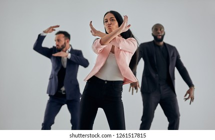 The happy three business people dancing