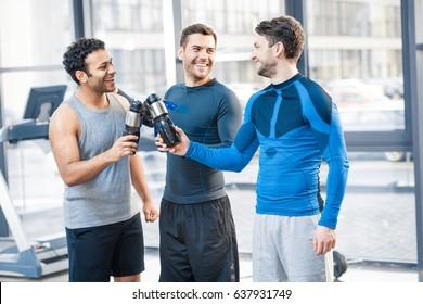 Happy three friends at sport club