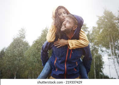 Happy time for loving couple in rain