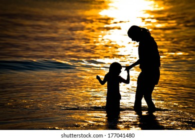 Happy time of mom and daughter at sunset