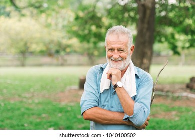 Happy time senior man in the garden on summer season,Relaxation time Concept,Cheerful elder man enjoying peaceful nature