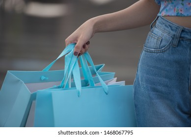Happy time to shopping concept , Asian woman holding shopping bags, close up.
