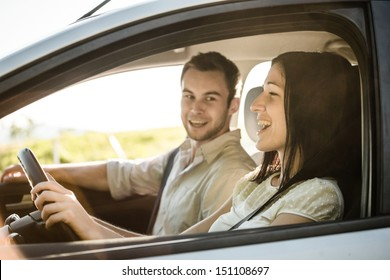 Happy time together - couple in car singing song