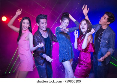 Happy time, Young people asians having fun dancing at party. New year's party, drinks, holidays and celebration concept.