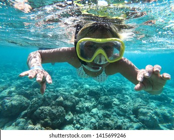 Happy time of young woman with bubble snorkeling in the tropical sea which Travel lifestyle and water sport concept