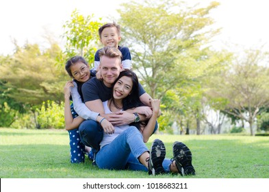 Happy times of young families in the Park. father, mother, daughter and son.