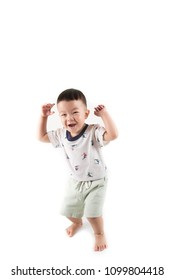Happy toddler boy jumpping with smile face say Huray on white background
