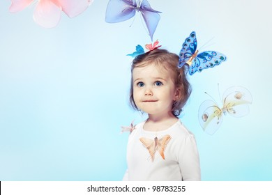 Happy toddler girl over blue background