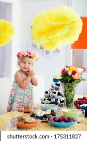 happy toddler girl and party decorating table indoor