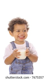 happy toddler with a glass of milk