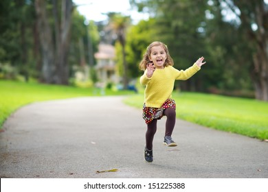 Happy Toddler Running in the Park