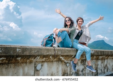 Happy tourist Asian couple relaxing together on vacation trip.