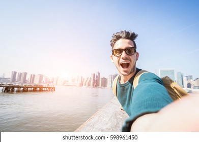 Happy tourist caucasian man having fun taking a selfie at New York city