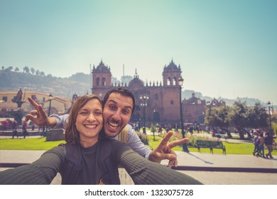 happy tourist couple taking selfie in the city of Cuzco in Peru, South America