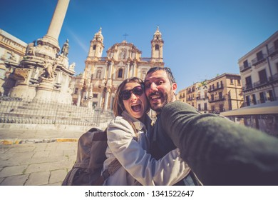 happy tourist couple taking selfie in Palermo in the San Domenico church in Palermo square, Sicily, Italy