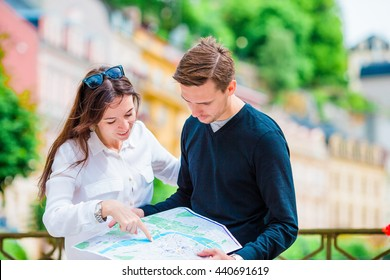 Happy tourist couple traveling on holidays in Europe smiling happy. Caucasian couple.