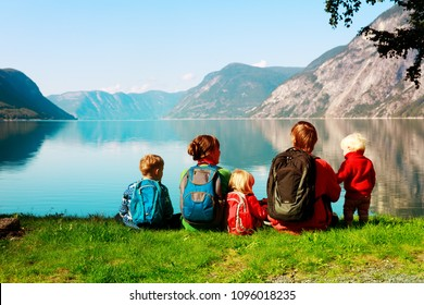 happy tourist family with kids travel looking at nature, Europe