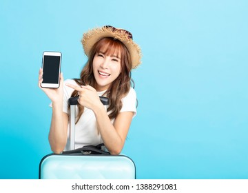 happy tourist girl in summer hat showing smart phone
