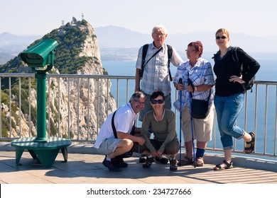Happy tourist people on the Rock of Gibraltar.