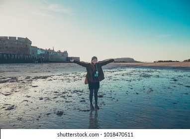 Happy tourist take photo with cityscape of Saint Malo, Brittany, France