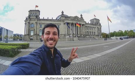 Happy tourist take selfie in Berlin, Germany