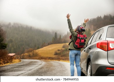 Happy tourist travelling in countryside