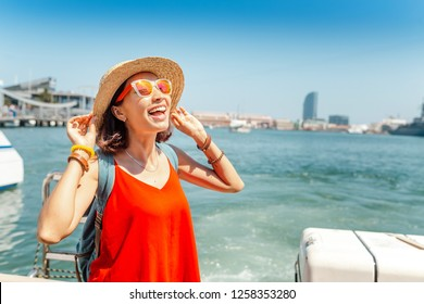 Happy tourist woman traveler standing on cruise ship or ferry boat