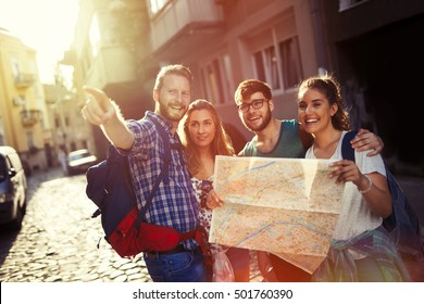 Happy tourists exploring travel destination city
