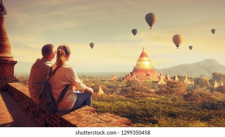 Happy tourists, friends, enjoy watching the flight of balloons over the old Bagan in Myanmar.