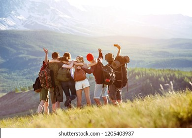 Happy tourists or friends are making selfie in mountains area. Travel or togetherness concept