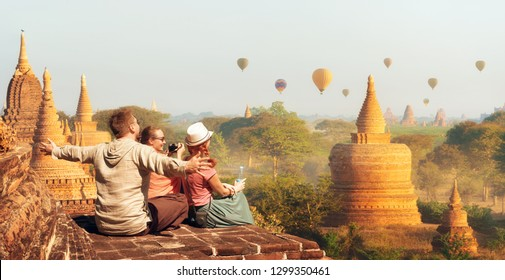 Happy tourists, friends, vacationers in the summer holidays in Old Bagan, Myanmar.