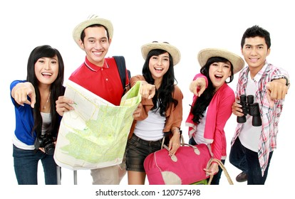 Happy tourists pointing to camera and one holding the map