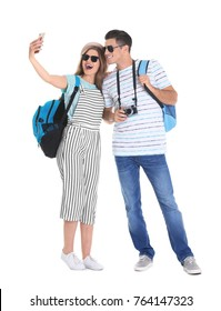 Happy tourists taking selfie on white background