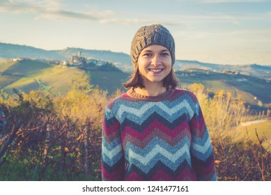 happy tourits girl in Castiglione Falletto, Langhe wine area region in Piedmont, Italy