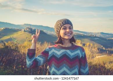 happy tourits girl in Castiglione Falletto, Langhe wine area region in Piedmont, Italy