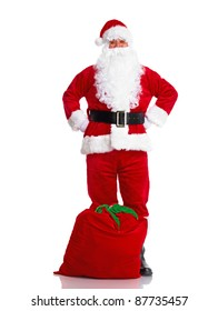 Happy traditional Santa Claus with bag. Christmas. Isolated on white background.