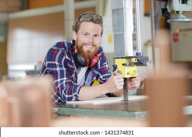 happy trainer in vocational training on a milling machine
