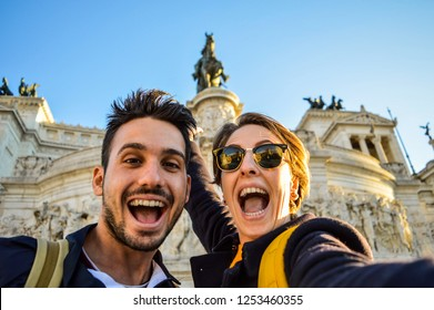 Happy travel couple taking selfie with the smartphone in famous landmark in la Piazza Venezia, Rome, Italy. Concept about travel, couple, lifestyle, technology, selfie and people